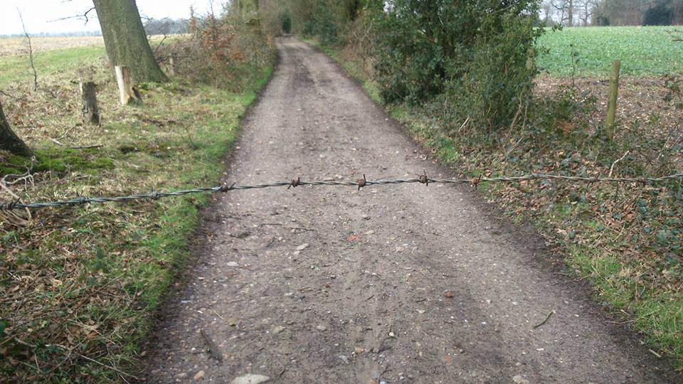 Barbed wire across a kent MTB trail