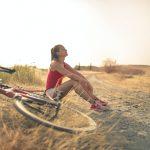 woman bicycle sunshine